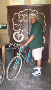 Navy veteran, Calvin, from the Gateway Center fourth floor shows off the bike he earned at Sopo.