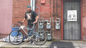 Nathaniel, a veteran of the US Army and Gateway resident, gets ready to ride off on his new Schwinn from Sopo.